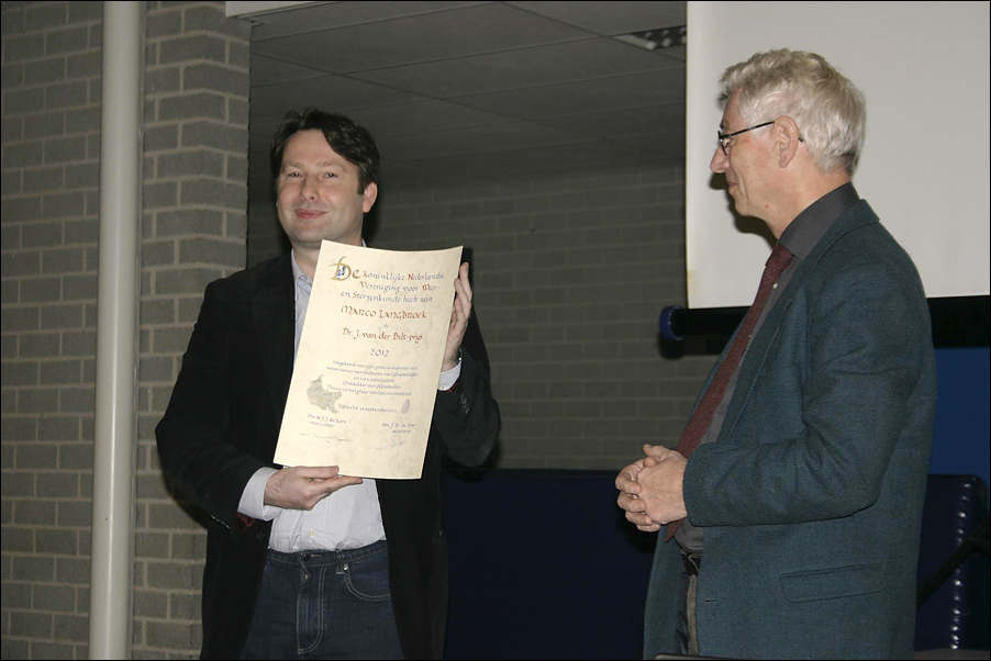 Marco receives an award from the Dutch Royal Astronomical Society